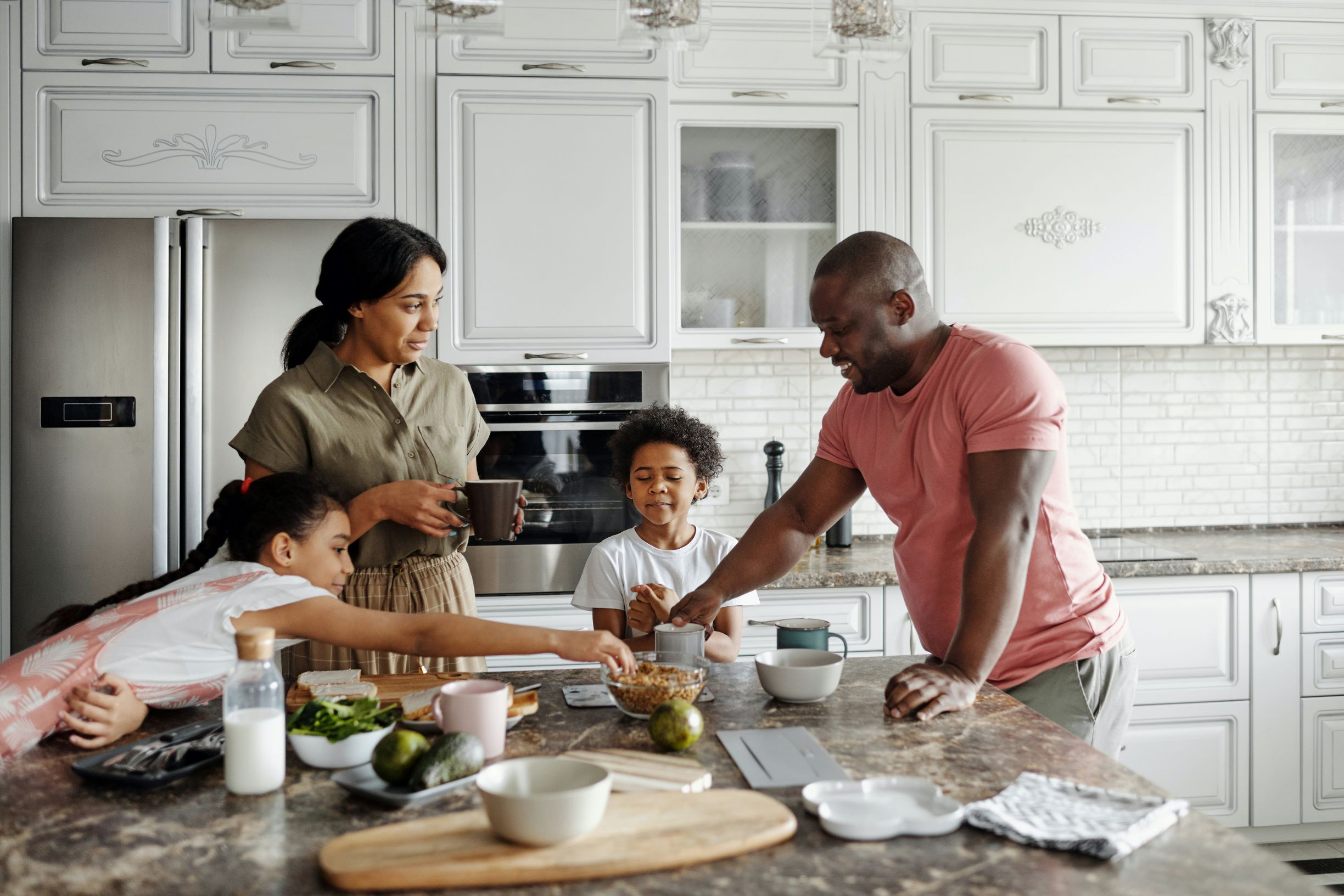 family-making-breakfast-in-the-kitchen-4259138
